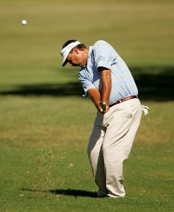 Brad Bryant hits from the fairway on the 1st hole during the first round of the AT&T Championship at Oak Hills Country Club on October 19, 2007 in San Antonio, Texas. Champions Tour - 2007 AT&T Championship - First RoundPhoto by S.Greenwood/WireImage.com
