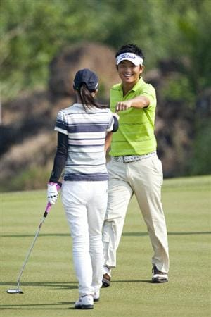HAIKOU, CHINA - OCTOBER 30: Golfer Ryuji Imada of Japan celebrate his shot with Actor Ai Katoh of Japan during day four of the Mission Hills Start Trophy tournament at Mission Hills Resort on October 30, 2010 in Haikou, China. The Mission Hills Star Trophy is Asia's leading leisure liflestyle event which features Hollywood celebrities and international golf stars.  (Photo by Athit Perawongmetha/Getty Images for Mission Hills)