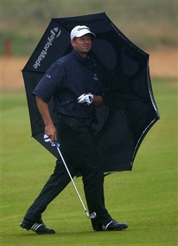 SOUTHPORT, UNITED KINGDOM - JULY 17:  Retief Goosen of South Africa waits under an umbrella on the 1st hole during the First Round of the 137th Open Championship on July 17, 2008 at Royal Birkdale Golf Club, Southport, England.  (Photo by Andrew Redington/Getty Images)