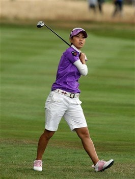 SUNNINGDALE, UNITED KINGDOM - AUGUST 02:  Momoko Ueda of Japan follows her second shot at the 1st hole during the third round of the 2008  Ricoh Women's British Open Championship held on the Old Course at Sunningdale Golf Club, on August 2, 2008 in Sunningdale, England.  (Photo by David Cannon/Getty Images)