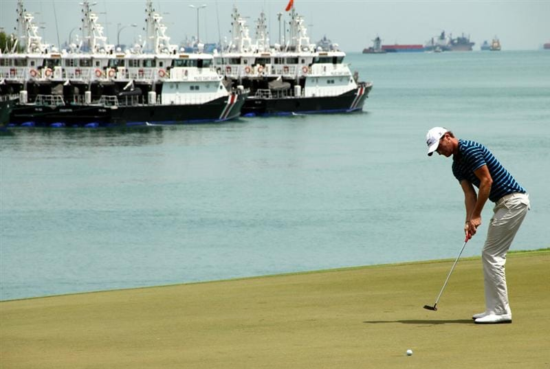 SINGAPORE - NOVEMBER 13: Chris Wood of England putts on the 6th hole during the Third Round of the Barclays Singapore Open held at the Sentosa Golf Club on November 13, 2010 in Singapore, Singapore.  (Photo by Stanley Chou/Getty Images)
