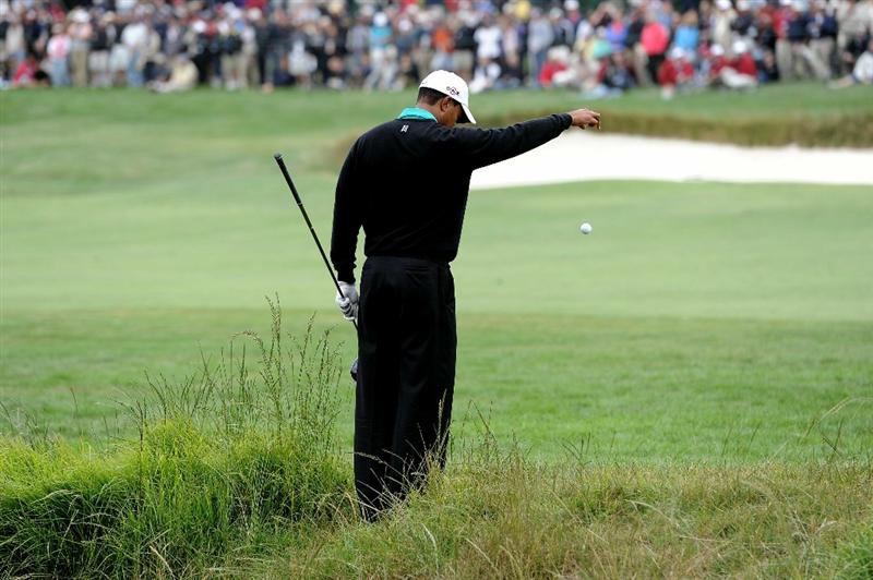 PEBBLE BEACH, CA - JUNE 18:  Tiger Woods takes a drop on the third hole during the second round of the 110th U.S. Open at Pebble Beach Golf Links on June 18, 2010 in Pebble Beach, California.  (Photo by Harry How/Getty Images)