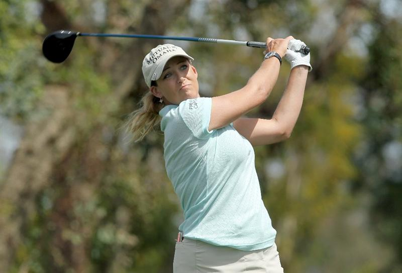 RANCHO MIRAGE, CA - APRIL 03:  Cristie Kerr hits her tee shot on  the third hole during the third round of the Kraft Nabisco Championship at Mission Hills Country Club on April 3, 2010 in Rancho Mirage, California.  (Photo by Stephen Dunn/Getty Images)