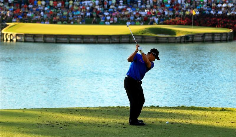 PONTE VEDRA BEACH, FL - MAY 15:  K.J. Choi of South Korea hits his tee shot on the 17th hole during the final round of THE PLAYERS Championship held at THE PLAYERS Stadium course at TPC Sawgrass on May 15, 2011 in Ponte Vedra Beach, Florida. Choi made a par-saving putt on the first playoff hole to defeat David Toms and win THE PLAYERS Championship. (Photo by Streeter Lecka/Getty Images)