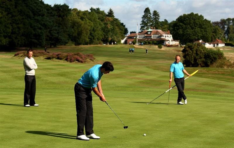 SUNNINGDALE, ENGLAND - SEPTEMBER 04:  Niall Kearney of Ireland putts as Wallace Booth of Scotland and former Walker Cup player and European Tour Pro Nick Dougherty of England watch on during a GB&I Walker Cup practise round at Sunningdale Golf Club on September 4, 2009 in Sunningdale, England.  (Photo by Richard Heathcote/Getty Images)