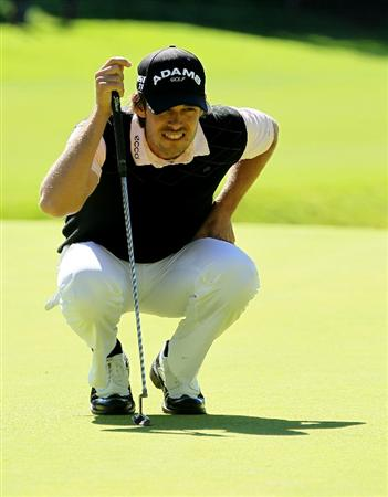 PACIFIC PALISADES, CA - FEBRUARY 20:  Aaron Baddeley of Australia lines up his putt on the eighth green during the final round of the Northern Trust Open at Riviera Country Club on February 20, 2011 in Pacific Palisades, California.  (Photo by Stephen Dunn/Getty Images)
