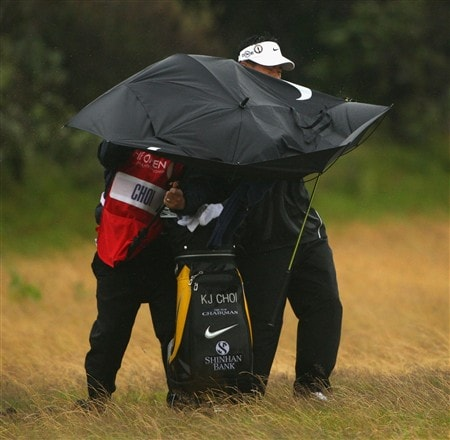 SOUTHPORT, UNITED KINGDOM - JULY 17:  KJ Choi of Korea tries to shelter from the rain on the 1st hole during the First Round of the 137th Open Championship on July 17, 2008 at Royal Birkdale Golf Club, Southport, England.  (Photo by Andrew Redington/Getty Images)