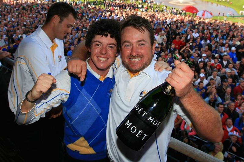 NEWPORT, WALES - OCTOBER 04:  (L-R) Rory McIlroy and Graeme McDowell of Europe celebrate on the balcony of the clubhouse following Europe's victory in the 2010 Ryder Cup at the Celtic Manor Resort on October 4, 2010 in Newport, Wales.  (Photo by David Cannon/Getty Images)