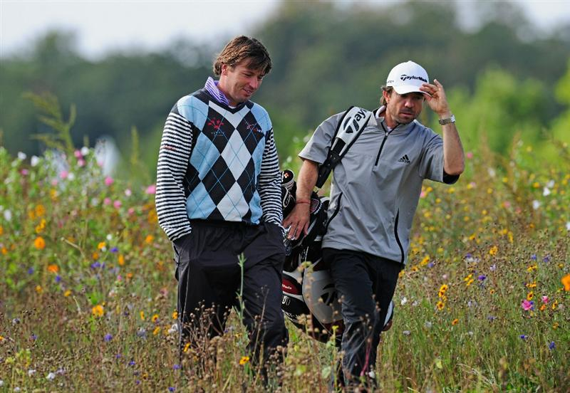 PARIS - SEPTEMBER 25:  Robert - Jan Derksen of The Netherlands and caddie walk between the flowers during the third round of the Vivendi cup at Golf de Joyenval on September 25, 2010 in Chambourcy, near Paris, France.  (Photo by Stuart Franklin/Getty Images)
