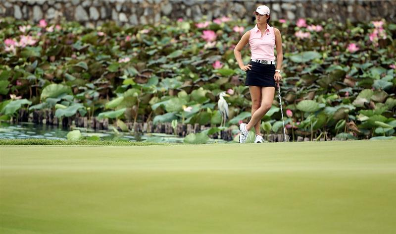 SINGAPORE - FEBRUARY 25:  Michelle Wie of the USA lines up a putt on the eighth hole during the first round of the HSBC Women's Champions at the Tanah Merah Country Club on February 25, 2010 in Singapore.  (Photo by Andrew Redington/Getty Images)