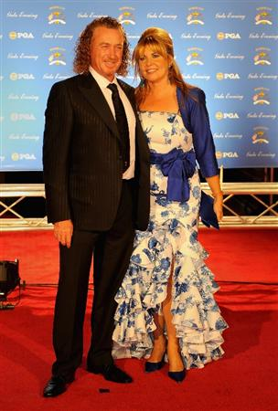 LOUISVILLE, KY - SEPTEMBER 17:  Miguel Angel Jimenez of Spain and the European Ryder Cup team poses with his wife Montserrat Bravo Ramirez on the red carpet before the Ryder Cup Gala dinner prior to the start of the 2008 Ryder Cup September 17, 2008 in Louisville, Kentucky.  (Photo by Sam Greenwood/Getty Images)