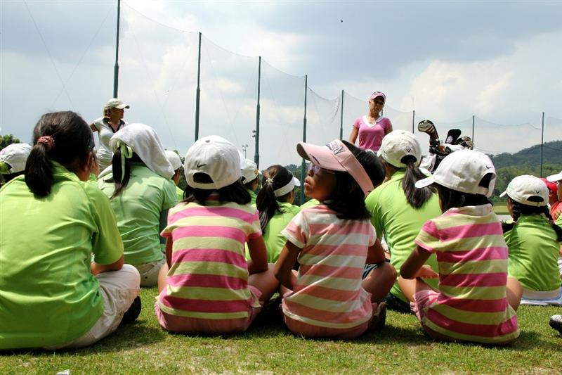 KUALA LUMPUR, MALAYSIA - OCTOBER 20:  Cristie Kerr (L) and Natalie Gulbis of USA speak to the kids during the Sime Darby LPGA Junior Clinics on October 20, 2010 held at the KLGCC Golf Course in Kuala Lumpur, Malaysia (Photo by Stanley Chou/Getty Images)