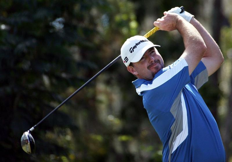 LAKE BUENA VISTA, FL - NOVEMBER 9:  Robert Garrigus tees off on the fourth hole, during the final round at the Children's Miracle Network Classic at Disney Magnolia golf course November 9, 2008 in Lake Buena Vista, Florida. (Photo by Marc Serota/Getty Images)