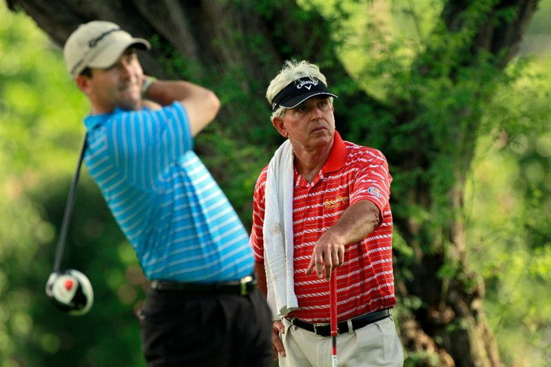 HONOLULU, HI - JANUARY 14:  Dave Eichelberger (R) watches Charles Warren play a shot on the 8th hole during the first round of the Sony Open at Waialae Country Club on January 14, 2011 in Honolulu, Hawaii.  (Photo by Sam Greenwood/Getty Images)