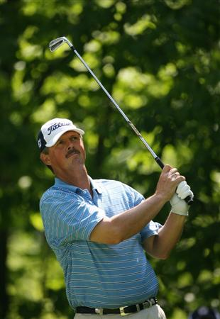 BEACHWOOD, OH - MAY 23:  Jay Don Blake hits his tee shot on the 13th hole during the third round of the 70th Senior PGA Championship at Canterbury Golf Club on May 23, 2009 in Beachwood, Ohio. (Photo by Hunter Martin/Getty Images)