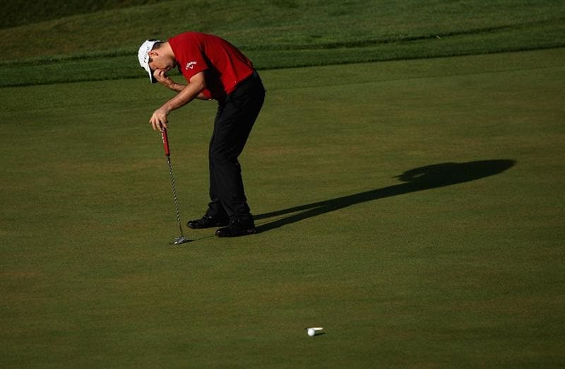 VILAMOURA, PORTUGAL - OCTOBER 15:  Oliver Wilson of England reacts after a missed putt on the 13th hole during the first round of the Portugal Masters at the Oceanico Victoria Golf Course on October 15, 2009 in Vilamoura, Portugal.  (Photo by Andrew Redington/Getty Images)