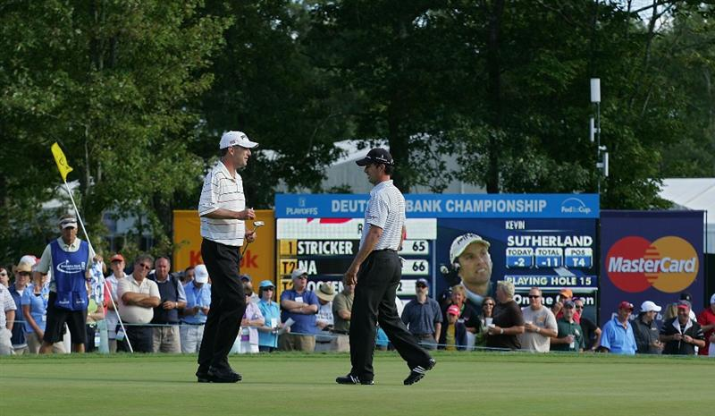 NORTON, MA - SEPTEMBER 06:  Kevin Sutherland (L) and Mike Weir share a laugh on the 15th green during the third round of the Deutsche Bank Championship at TPC Boston held on September 6, 2009 in Norton, Massachusetts.  (Photo by Michael Cohen/Getty Images)