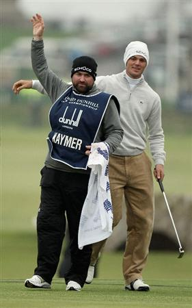 ST ANDREWS, SCOTLAND - OCTOBER 10:  Martin Kaymer of Germany celebrates with his caddie Craig Connolly after holing a birdie putt on the 17th green on his way to victory in the final round of The Alfred Dunhill Links Championship at The Old Course on October 10, 2010 in St Andrews, Scotland.  (Photo by Ross Kinnaird/Getty Images)