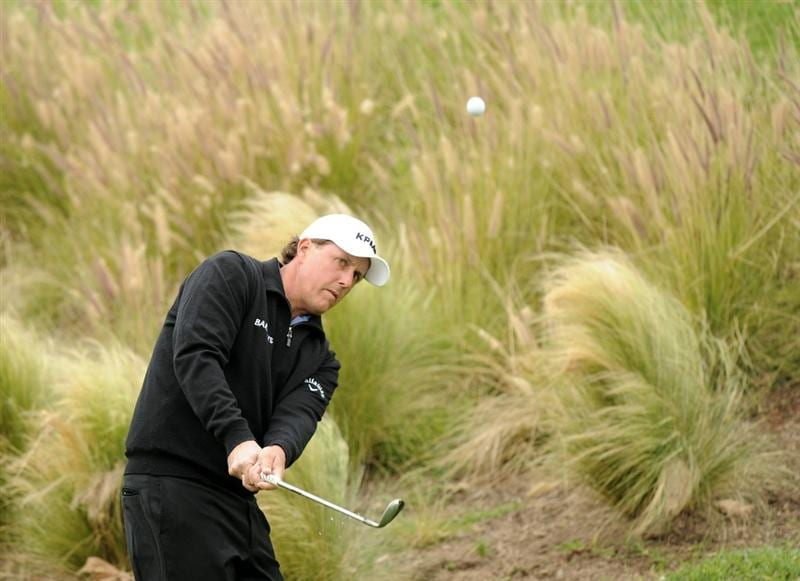 PACIFIC PALISADES, CA - FEBRUARY 18:  Phil Mickelson chips out of the rough on the third hole during the second round of the Northern Trust Open at the Riviera Country Club on February 18, 2011 in Pacific Palisades, California.  (Photo by Harry How/Getty Images)