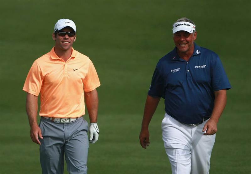 BAHRAIN, BAHRAIN - JANUARY 29:  Paul Casey of England (left) and Darren Clarke of Northern Ireland share a joke during the third round of the Volvo Golf Champions at The Royal Golf Club on January 29, 2011 in Bahrain, Bahrain.  (Photo by Andrew Redington/Getty Images)