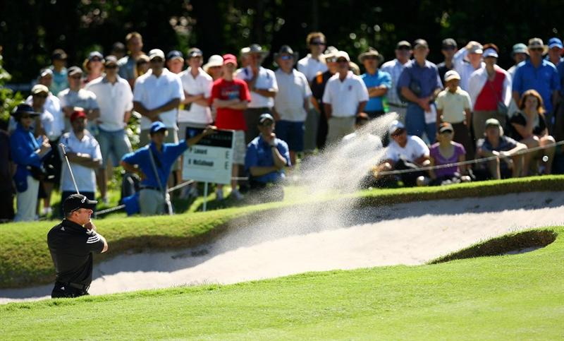 SYDNEY, AUSTRALIA - DECEMBER 14: Peter Lonard of Australia chips from a bunker on the first hole during the fourth round of the 2008 Australian Open at The Royal Sydney Golf Club on December 14, 2008 in Sydney, Australia.  (Photo by Mark Nolan/Getty Images)