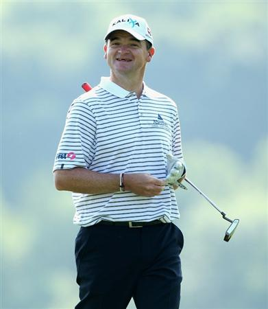 NEWPORT, WALES - JUNE 04:  Paul Lawrie of Scotland smiles after hitting his second shot on the 16th hole during the second round of the Celtic Manor Wales Open on The Twenty Ten Course at The Celtic Manor Resort on June 4, 2010 in Newport, Wales.  (Photo by Andrew Redington/Getty Images)