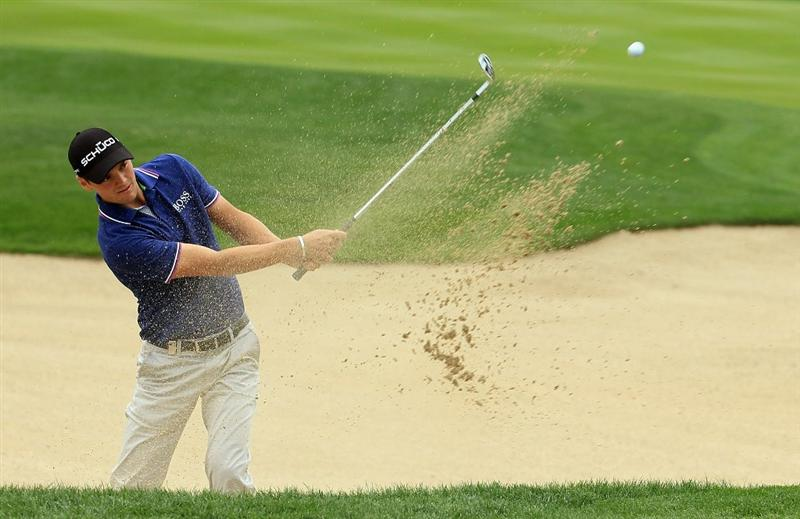 ABU DHABI, UNITED ARAB EMIRATES - JANUARY 21:  Martin Kaymer of Germany plays a bunker shot on the 13th hole during the second round of The Abu Dhabi HSBC Golf Championship at Abu Dhabi Golf Club on January 21, 2011 in Abu Dhabi, United Arab Emirates.  (Photo by Andrew Redington/Getty Images)