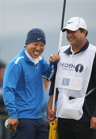 TURNBERRY, SCOTLAND - JULY 17:  Anthony Kim of USA shares a joke with caddy Eric Larson during round two of the 138th Open Championship on the Ailsa Course, Turnberry Golf Club on July 17, 2009 in Turnberry, Scotland.  (Photo by Warren Little/Getty Images)