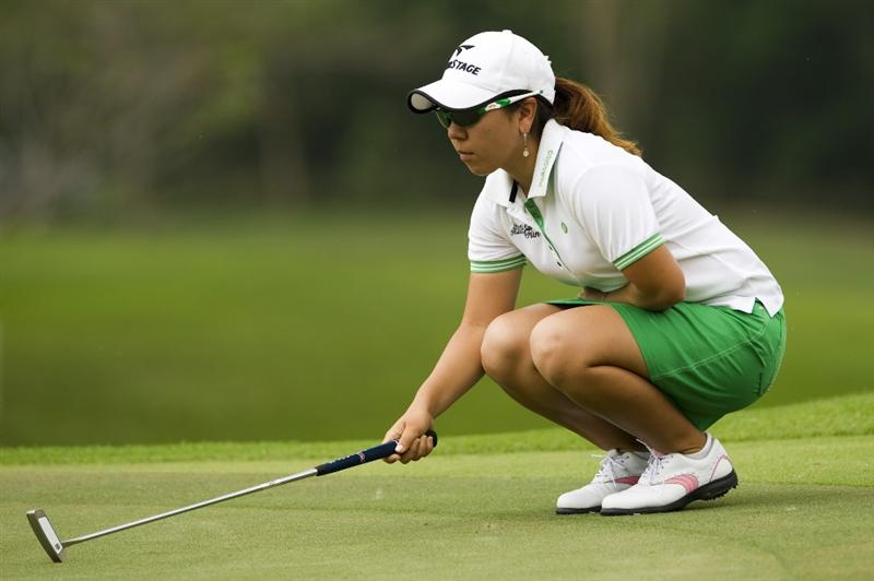 CHON BURI, THAILAND - FEBRUARY 20:  Mika Miyazato of Japan lines up a putt on the 8th green during round three of the Honda PTT LPGA Thailand at Siam Country Club on February 20, 2010 in Chon Buri, Thailand.  (Photo by Victor Fraile/Getty Images)