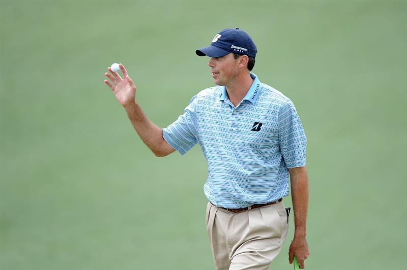 AUGUSTA, GA - APRIL 08:  Matt Kuchar waves to the gallery on the second green during the first round of the 2010 Masters Tournament at Augusta National Golf Club on April 8, 2010 in Augusta, Georgia.  (Photo by Harry How/Getty Images)