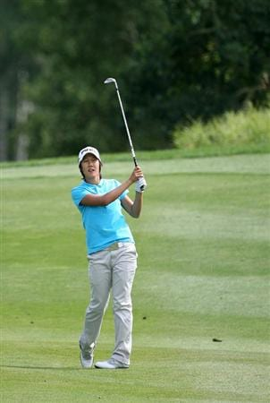 CALGARY, AB - SEPTEMBER 04 : Song-Hee Kim of South Korea watches her third shot on the 18th hole during the second round of the Canadian Women's Open at Priddis Greens Golf & Country Club on September 4, 2009 in Calgary, Alberta, Canada. (Photo by Hunter Martin/Getty Images)