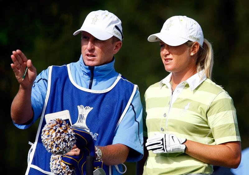 SUGAR GROVE, IL - AUGUST 22:  Suzann Pettersen of the European Team chats with her caddie Shaun McBride on the third tee during the saturday morning fourball matches at the 2009 Solheim Cup at Rich Harvest Farms on August 22, 2009 in Sugar Grove, Illinois.  (Photo by Scott Halleran/Getty Images)