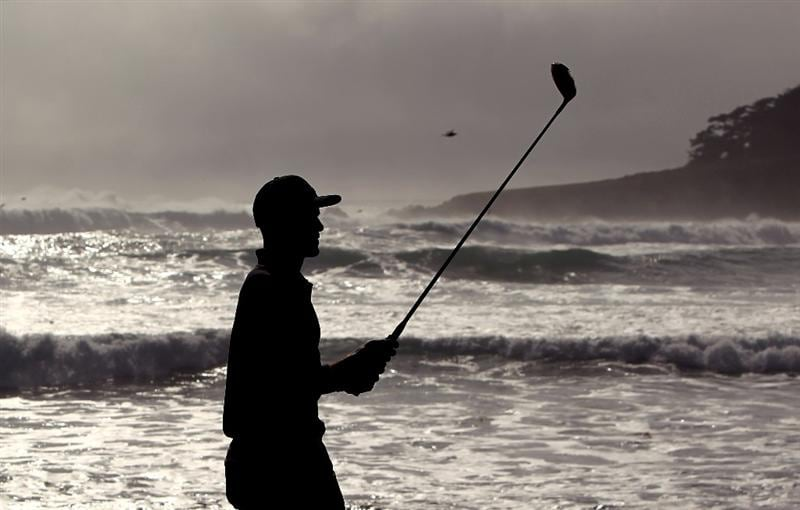 PEBBLE BEACH, CA - FEBRUARY 13:  Professional surfer Kelly Slater walks down the fairway on the 18th hole during round three of the AT&T Pebble Beach National Pro-Am at Pebble Beach Golf Links on February 13, 2010 in Pebble Beach, California.  (Photo by Ezra Shaw/Getty Images)