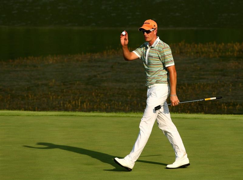 SUN CITY, SOUTH AFRICA - DECEMBER 06:  Henrik Stenson of Sweden reacts to a birdie on the 17th green during the third round of the Nedbank Golf Challenge at the Gary Player Country Club on December 6, 2008 in Sun City, South Africa.  (Photo by Richard Heathcote/Getty Images)