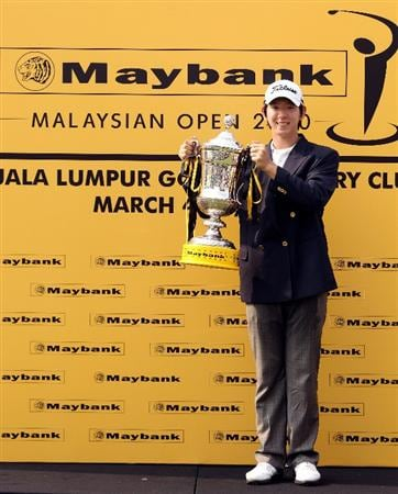 KUALA LUMPUR, MALAYSIA - MARCH 07:  Noh Seung-Yul of Korea with the winners trophy after the final round of the Maybank Malaysia Open at the Kuala Lumpur Golf & Country on March 7, 2010 in Kuala Lumpur, Malaysia.  (Photo by Ross Kinnaird/Getty Images)
