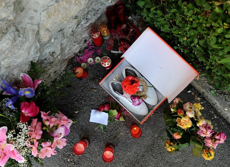 PEDRENA, SPAIN - MAY 10:  A pair of golf shoes lay amid candles lit in memory of legendary Spanish golfer Seve Ballesteros, outside his home on May 10, 2011 in Pedrena, Spain.  (Photo by Jasper Juinen/Getty Images)