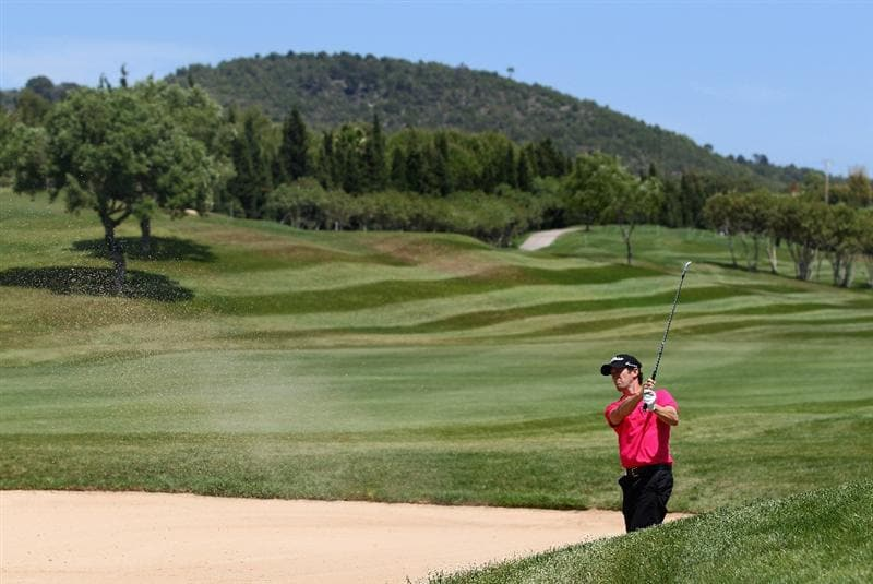MALLORCA, SPAIN - MAY 12:  Gregory Bourdy of France plays out of a bunker on the 9th hole during day one of the Iberdrola Open at Pula Golf Club on May 12, 2011 in Mallorca, Spain.  (Photo by Julian Finney/Getty Images)