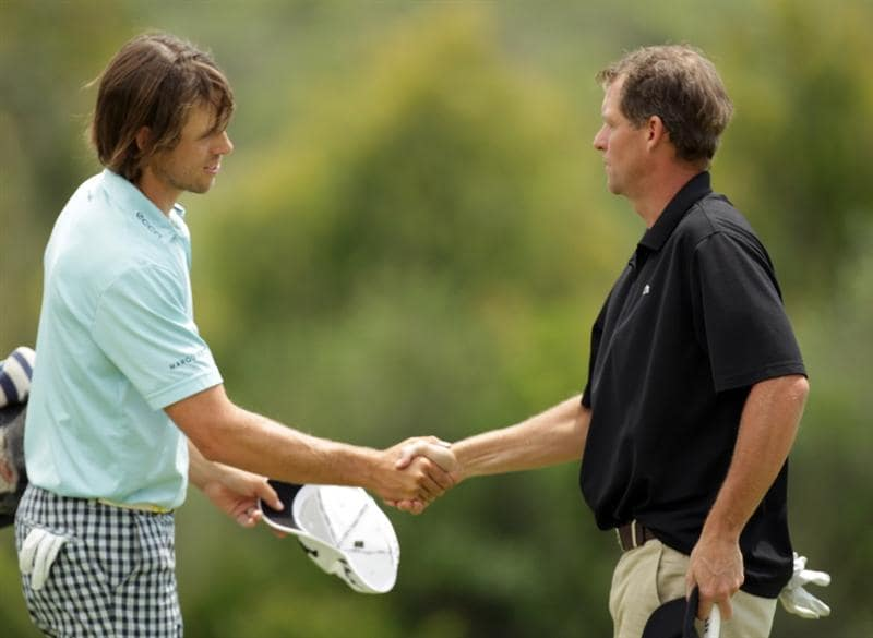 CASARES, SPAIN - MAY 20:  Aaron Baddeley of Australia is congratulated by Anders Hansen of Denmark after his win during the group stages of the Volvo World Match Play Championship at Finca Cortesin on May 20, 2011 in Casares, Spain.  (Photo by Ross Kinnaird/Getty Images)