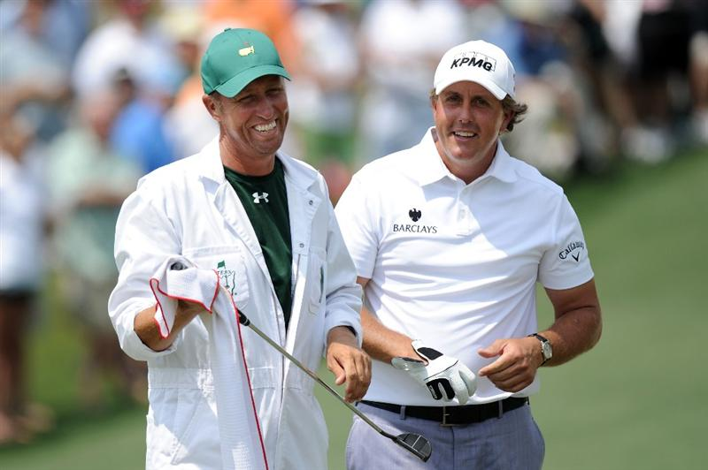 AUGUSTA, GA - APRIL 09:  Phil Mickelson chats with his caddie Jim Mackay on the second hole during the third round of the 2011 Masters Tournament at Augusta National Golf Club on April 9, 2011 in Augusta, Georgia.  (Photo by Harry How/Getty Images)