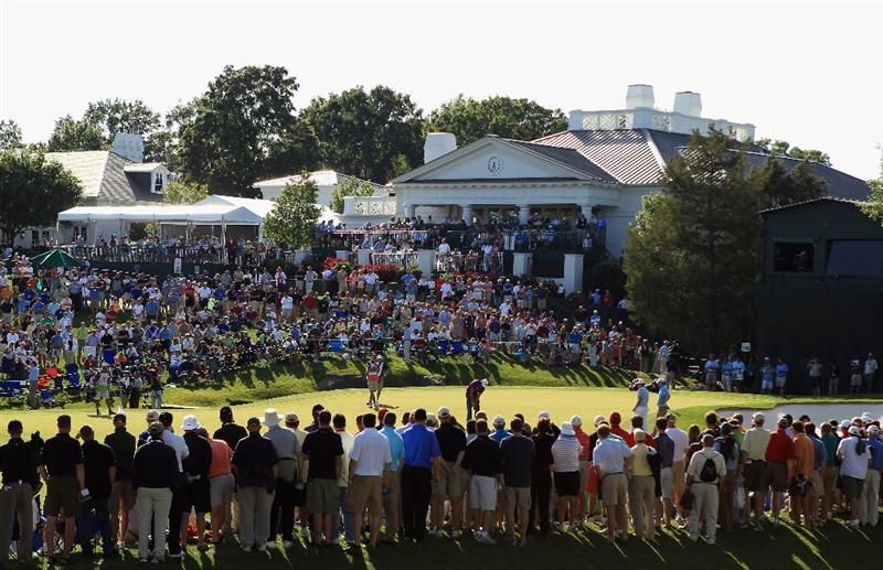 CHARLOTTE, NC - MAY 05:  Phil Mickelson putts the ball as crowds watch on at the 18th hole during the first round of the Wells Fargo Championship at Quail Hollow Club on May 5, 2011 in Charlotte, North Carolina.  (Photo by Streeter Lecka/Getty Images)
