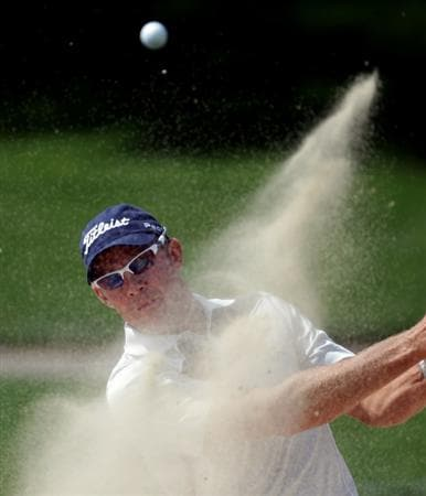 DUBAI, UNITED ARAB EMIRATES - FEBRUARY 13:  James Kingston of South Africa holes his bunker shot on the first hole during the final round of the Omega Dubai Desert Classic on the Majlis course at the Emirates Golf Club on February 13, 2011 in Dubai, United Arab Emirates.  (Photo by Ross Kinnaird/Getty Images)