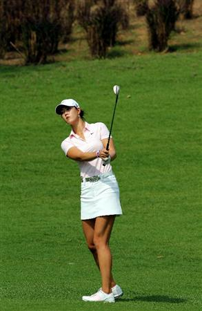 KUALA LUMPUR, MALAYSIA - OCTOBER 23:  Michelle Wie of USA watches her 2nd shot on the 1st hole during Round Two of the Sime Darby LPGA at the Kuala Lumpur Golf and Country Club on October 23, 2010 in Kuala Lumpur, Malaysia. (Photo by Stanley Chou/Getty Images)
