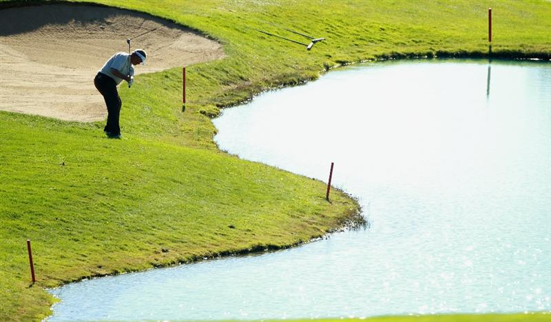 CRANS, SWITZERLAND - SEPTEMBER 03:  Darren Clarke of Northern Ireland chips onto the 14th green during the second round of The Omega European Masters at Crans-Sur-Sierre Golf Club on September 3, 2010 in Crans Montana, Switzerland.  (Photo by Warren Little/Getty Images)