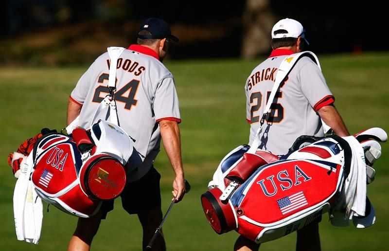 SAN FRANCISCO - OCTOBER 07:  Caddies Steve Williams, (L) and Jimmy Johnson walk up a fairway during a practice round prior to the start of The Presidents Cup at Harding Park Golf Course on October 7, 2009 in San Francisco, California.  (Photo by Scott Halleran/Getty Images)
