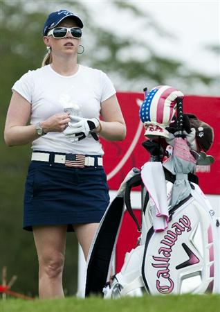CHON BURI, THAILAND - FEBRUARY 17:  Morgan Pressel of USA adjusts her glove on the 16th green during day one of the LPGA Thailand at Siam Country Club on February 17, 2011 in Chon Buri, Thailand.  (Photo by Victor Fraile/Getty Images)