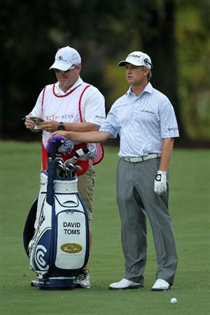 PONTE VEDRA BEACH, FL - MAY 14:  David Toms and his caddie Scott Gneiser look on from the fourth fairway during the third round of THE PLAYERS Championship held at THE PLAYERS Stadium course at TPC Sawgrass on May 14, 2011 in Ponte Vedra Beach, Florida.  (Photo by Mike Ehrmann/Getty Images)