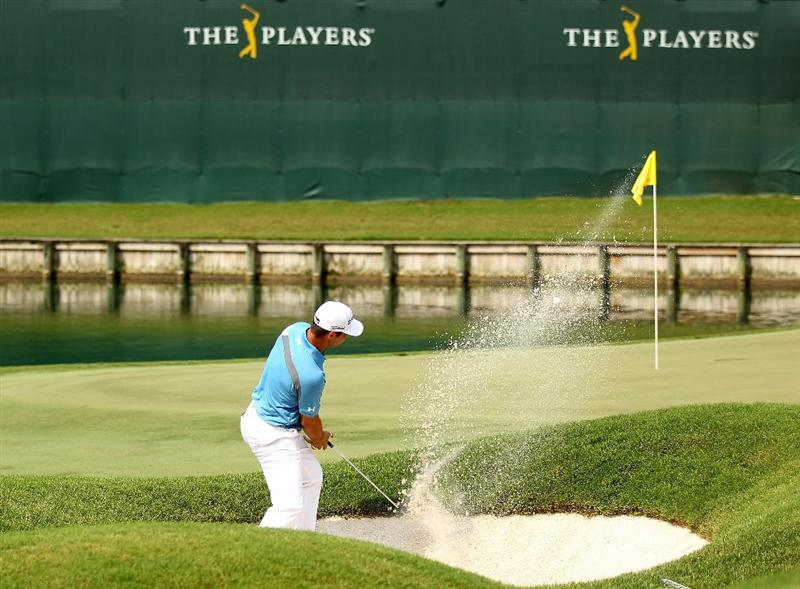 PONTE VEDRA BEACH, FL - MAY 13:  Gary Woodland hits from a bunker on the 18th hole during the second round of THE PLAYERS Championship held at THE PLAYERS Stadium course at TPC Sawgrass on May 13, 2011 in Ponte Vedra Beach, Florida.  (Photo by Mike Ehrmann/Getty Images)