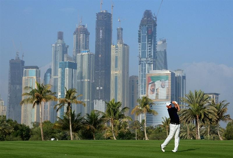 DUBAI, UNITED ARAB EMIRATES - FEBRUARY 10:  Thomas Bjorn of Denmark in action during the first round of the Omega Dubai Desert Classic on the Majlis course at the Emirates Golf Club on February 10, 2011 in Dubai, United Arab Emirates.  (Photo by Andrew Redington/Getty Images)