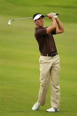 JOHANNESBURG, SOUTH AFRICA - JANUARY 15:  Charl Schwartzel of South Africa plays his second shot into the 14th green during the third round of the Joburg Open at Royal Johannesburg and Kensington Golf Club on January 15, 2011 in Johannesburg, South Africa.  (Photo by Warren Little/Getty Images)