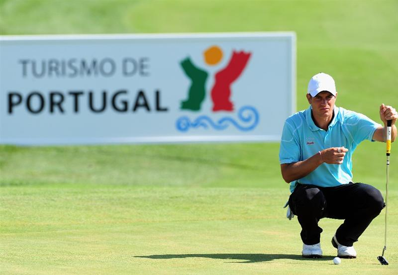 VILAMOURA, PORTUGAL - OCTOBER 15:  Mads Vibe-Hastrup of Denmark lines up his putt on the 18th hole during the first round of the Portugal Masters at the Oceanico Victoria Golf Course on October 15, 2009 in Vilamoura, Portugal.  (Photo by Stuart Franklin/Getty Images)